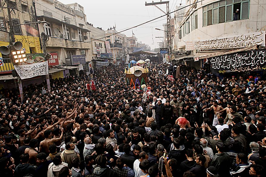Shi'ite Muslims take part in a Muharram procession in Lahore, Pakistan, on Thursday, Dec. 16, 2010. Muharram is observed around the world for ten days as mourning in remembrance of the martyrdom of Imam Hussein, the grandson of Prophet Muhammad. (AP Photo/K.M. Chaudary)