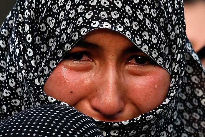 A Shi'ite Muslim woman joins the mourning during a Muharram procession in Islamabad, Pakistan, on Thursday, Dec. 16, 2010. Muharram is observed around the world for ten days in remembrance of the martyrdom of Imam Hussein, the grandson of Prophet Muhammad. (AP Photo/Anjum Naveed)
