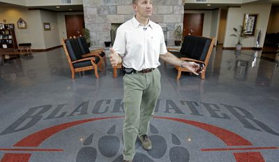 In this July 2008 file photo, Erik Prince, founder and CEO of then Blackwater Worldwide, now called Xe Services, speaks at the company's offices in Moyock, N.C. An investment group with ties to Mr. Prince has bought the security firm, it was announced Friday, Dec. 17, 2010. (AP Photo/Gerry Broome, File)