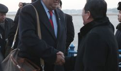 ** FILE ** Then-New Mexico Gov. Bill Richardson (left) is greeted by Li Gun of the North Korean Foreign Ministry's American Affairs Department upon arriving at the Pyongyang airport on Thursday, Dec. 16, 2010. (AP Photo/APTN)
