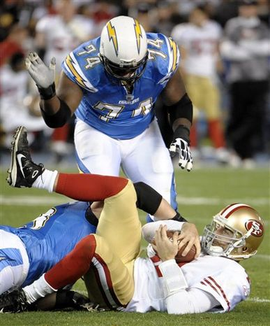 San Diego Chargers wide receiver Vincent Jackson, left, make a catch on his way to a touchdown in the second quarter as San Francisco 49ers linebacker Takeo Spikes (51) chases him during an NFL football game, Thursday, Dec. 16, 2010, in San Diego. (AP Photo/Denis Poroy)