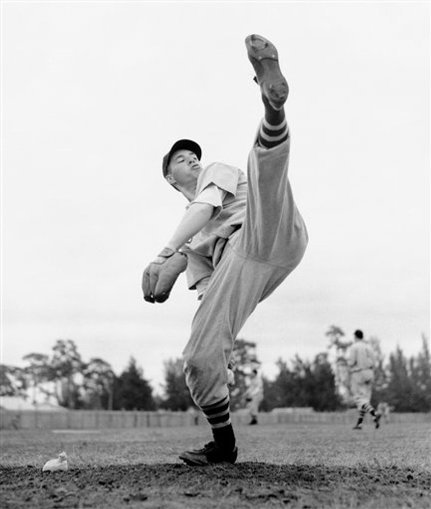 "FILE- In this Feb. 28, 1941, file photo, Cleveland Indians star pitcher Bob Feller works on his form during spring training baseball in Fort Myers, Fla. Feller, the Iowa farm boy whose powerful right arm earned him the nickname ""Rapid Robert"" and made him one of baseball's greatest pitchers during a Hall of Fame career with the Indians, has died Wednesday, Dec. 15, 2010. He was 92.  (AP Photo/File)"
