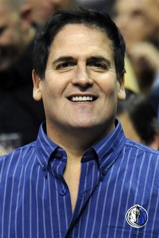"""FILE - In this Nov. 3, 2010, file photo, Dallas Mavericks owner Mark Cuban looks on during the first half of an NBA basketball game against the Denver Nuggets in Denver.  BCS executive director Bill Hancock says he doubts """"financial inducements,"""" such as the oneCuban is considering, will lead to a major college football playoff. Cuban told ESPNDallas.com on Wednesday that he was """"actively interested but in the exploratory stage"""" of trying to bankroll a 12- or 16-team playoff that would replace the controversial Bowl Championship Series.   (AP Photo/Jack Dempsey, File)"""