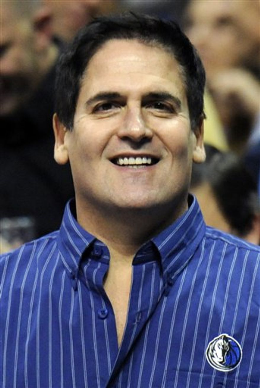 "FILE - In this Nov. 3, 2010, file photo, Dallas Mavericks owner Mark Cuban looks on during the first half of an NBA basketball game against the Denver Nuggets in Denver.  BCS executive director Bill Hancock says he doubts ""financial inducements,"" such as the oneCuban is considering, will lead to a major college football playoff. Cuban told ESPNDallas.com on Wednesday that he was ""actively interested but in the exploratory stage"" of trying to bankroll a 12- or 16-team playoff that would replace the controversial Bowl Championship Series.   (AP Photo/Jack Dempsey, File)"