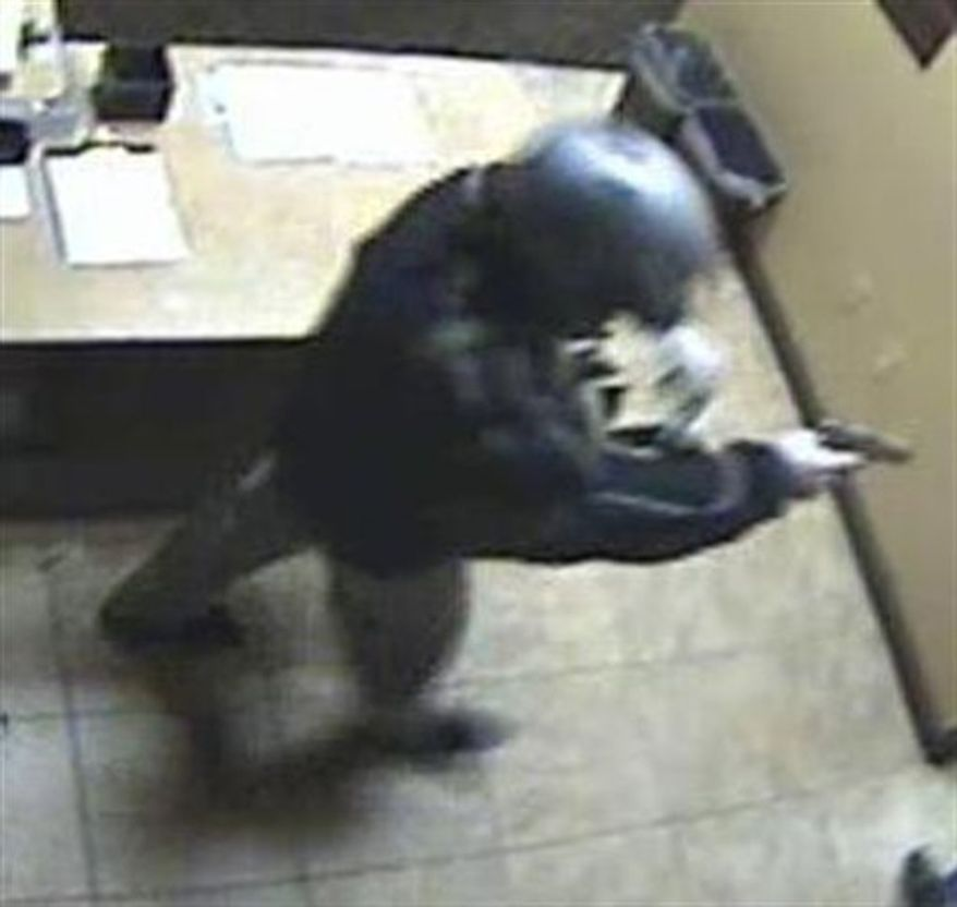 In this surveillance video frame grab  released Tuesday Dec.14,2010 by the Las Vegas Metropolitan Police Department showing a bandit wearing a motorcycle helmet during an armed robbery Thursday Dec. 9,2010 at the Las Vegas Suncoast Casino. Police believe it's the same man who who escaped on a motorcycle with about $1.5 million worth of casino chips from the posh Bellagio early Tuesday Dec.14, 2010.(AP Photo/Las Vegas Metropolitan Police Department)