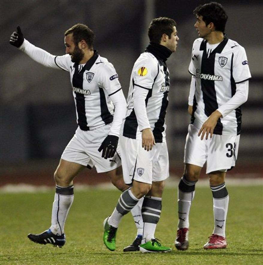 PAOK Salonika's Dimitris Salpingidis , left,  celebrates with his teammates t a goal during the Europa League group D soccer match with NK Dinamo Zagreb in Zagreb, Croatia, Wednesday, Dec. 15, 2010. (AP Photo/Filip Horvat)