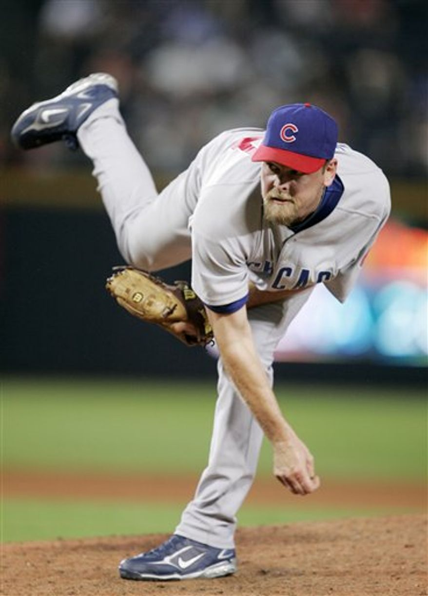 FILE - In this Aug. 13, 2008 file photo, Chicago Cubs pitcher Kerry Wood throws against the Atlanta Braves in the eighth inning of a baseball game in Atlanta. Wood is returning to the Chicago Cubs, agreeing to a one-year, $1.5 million contract, a person familiar with the negotiations told The Associated Press. The person spoke Thursday, Dec. 16, 2010, on condition of anonymity because the agreement had not yet been announced.  (AP Photo/John Bazemore, File)