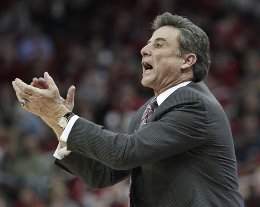 Louisville coach Rick Pitino applauds his team's efforts against Drexel in their NCAA college basketball game in Louisville, Ky., Tuesday, Dec. 14, 2010. Unranked Drexel upset No. 20 Louisville 52-46. (AP Photo/Garry Jones)