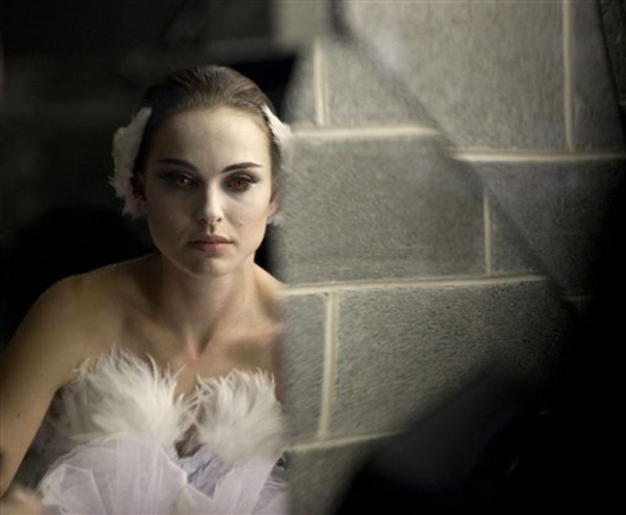 """In this film publicity image released by Fox Searchlight, Natalie Portman is shown in a scene from """"Black Swan."""" (AP Photo/Fox Searchlight, Niko Tavernise)"""
