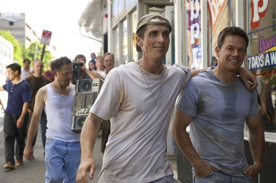 "In this publicity image released by Paramount Pictures, Christian Bale, and Mark Wahlberg, right, are shown in a scene from, ""The Fighter.""  (AP Photo/Paramount Pictures, Jojo Whilden)"