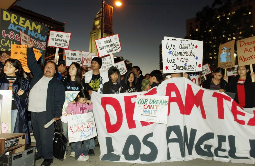 Immigrant parents, students and others participate in a candle-light procession and vigil in support of the Federal Dream Act in downtown Los Angeles on Dec. 7, 2010. The Senate on Saturday, Dec. 18, 2010, blocked the bill that would have granted legal status to hundreds of thousands of illegal immigrant children and young adults.(AP Photo/Damian Dovarganes)