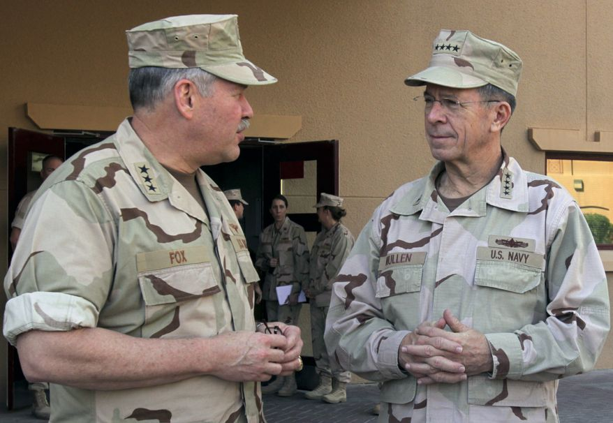 Adm. Mike Mullen, chairman of the U.S. Joint Chiefs of Staff, right, talks with Vice Adm. Mark Fox, commander of U.S. naval forces Central Command, following a press conference at the U.S. military base in Manama, Bahrain, Saturday, Dec. 18, 2010. (AP Photo/Hasan Jamali)