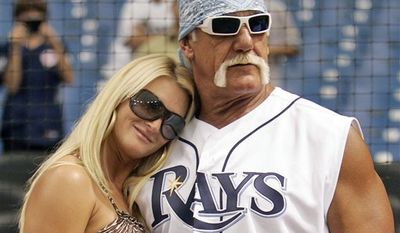 FILE - In this Sept. 3, 2008 file photo, restler Hulk Hogan, right, and his then girlfriend, Jennifer McDaniel, watch the New York Yankees take batting practice before a baseball game against the Tampa Bay Rays in St. Petersburg, Fla. The celebrity wrestler and McDaniel were married at Hogan's Clearwater Beach home Tuesday, Dec. 14, 2010, during a small, private ceremony, his attorney said. (AP Photo/Chris O'Meara, File)