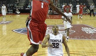 FILE - In this Dec. 8, 2010, file photo, San Diego State's Billy White dunks against California during the second half of an NCAA college basketball game in Berkeley, Calif. (AP Photo/Ben Margot, File)