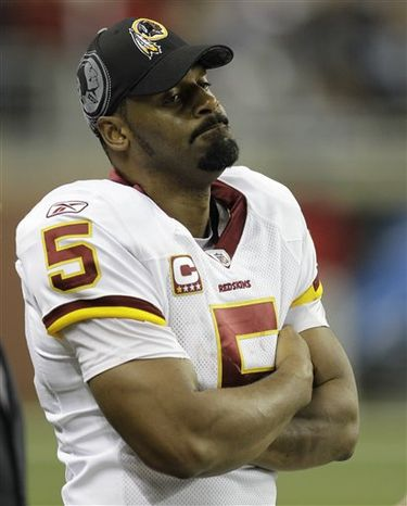 FILE - This Oct. 31, 2010, file photo shows Washington Redskins quarterback Donovan McNabb on from the sidelines after being benched during the fourth quarter of an NFL football game against the Detroit Lions, in Detroit. A person with knowledge of the situation says the Redskins plan to start Rex Grossman at quarterback over McNabb on Sunday, against the Dallas Cowboys. The person spoke to The Associated Press on condition of anonymity on Friday, Dec. 17, 2010,  because coach Mike Shanahan had yet to announce the switch. (AP Photo/Paul Sancya, File)