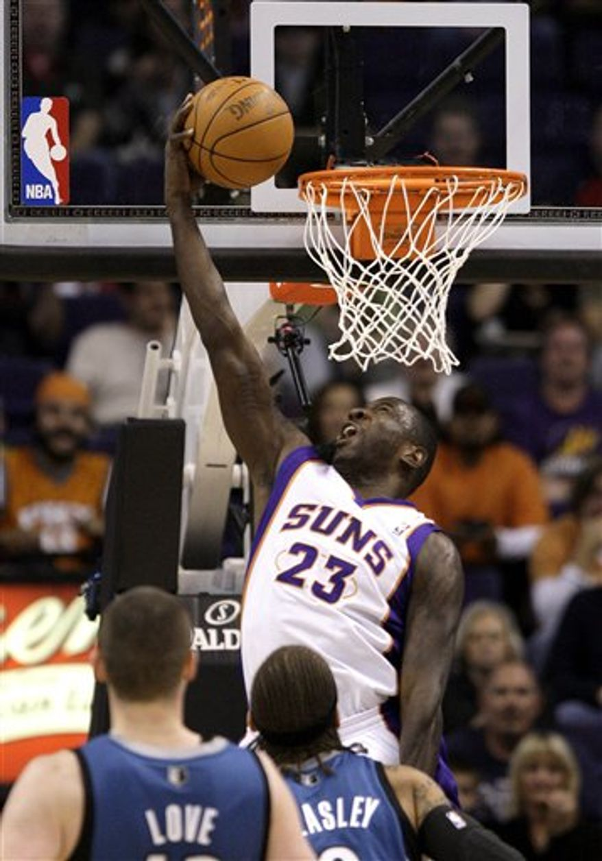 Phoenix Suns' Jason Richardson (23) dunks the ball as Minnesota Timberwolves' Kevin Love, front left, and Michael Beasley look on during the first quarter of an NBA basketball game Wednesday, Dec. 15, 2010, in Phoenix. (AP Photo)