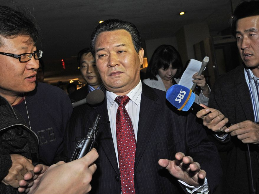 North Korea's ambassador to the United Nations, Sin Son-ho, declines to answer questions at the United Nations on Sunday, Dec. 19, 2010. The U.N. Security Council is holding an emergency meeting on rising tensions on the Korean peninsula. (AP Photo/ Louis Lanzano)