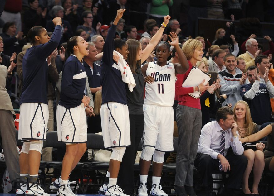 Connecticut celebrates in the final seconds of its 81-50 win over Ohio State in an NCAA college basketball game in the Maggie Dixon Classic at Madison Square Garden in New York, Sunday, Dec. 19, 2010. (AP Photo/Henny Ray Abrams)