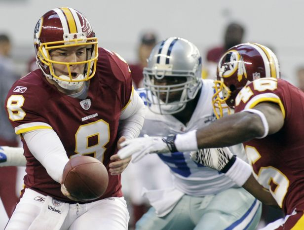 Washington Redskins quarterback Rex Grossman hands the ball off to Ryan Torain during the first half against the Dallas Cowboys at an NFL football game, Sunday, Dec. 19, 2010 in Arlington, Texas. (AP Photo/Sharon Ellman)