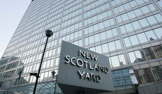 British police, headquartered at New Scotland Yard in London, on Monday arrested a dozen men suspected of plotting a large-scale terror attack. (AP Photo)
