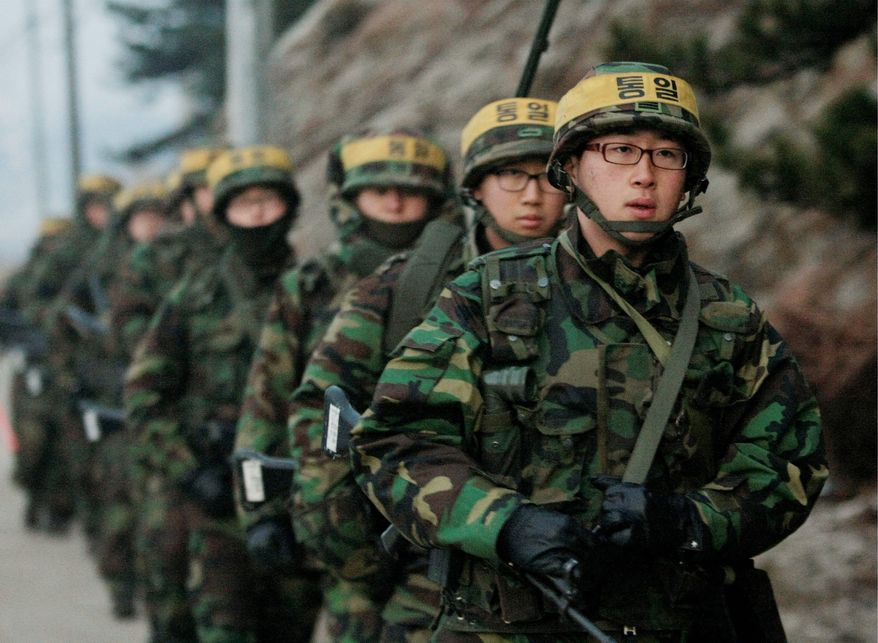 ASSOCIATED PRESS ON PATROL: The South Korean military patrols on Yeonpyeong Island on Tuesday. Yeonpyeong straddles the disputed maritime border between the Koreas.