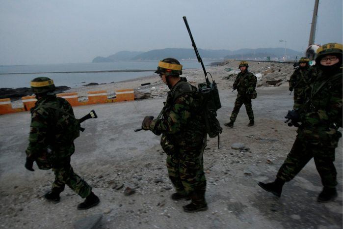 Associated Press South Korean marines patrol on Yeonpyeong Island on Tuesday. North Korea backed off threats to retaliate against South Korea for Seoul's military drills near the border Monday and reportedly offered concessions on its nuclear program.