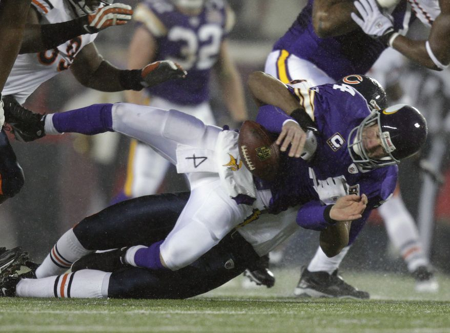 Minnesota Vikings quarterback Brett Favre is sacked by Chicago Bears' Corey Wootton during the second quarter of an NFL football game Monday, Dec. 20, 2010, at the University of Minnesota's TCF Bank Stadium in Minneapolis. Favre left the game after the play. The game was moved from the Metrodome, the roof of which was damaged by snow. (AP Photo/Star Tribune, Brian Peterson)