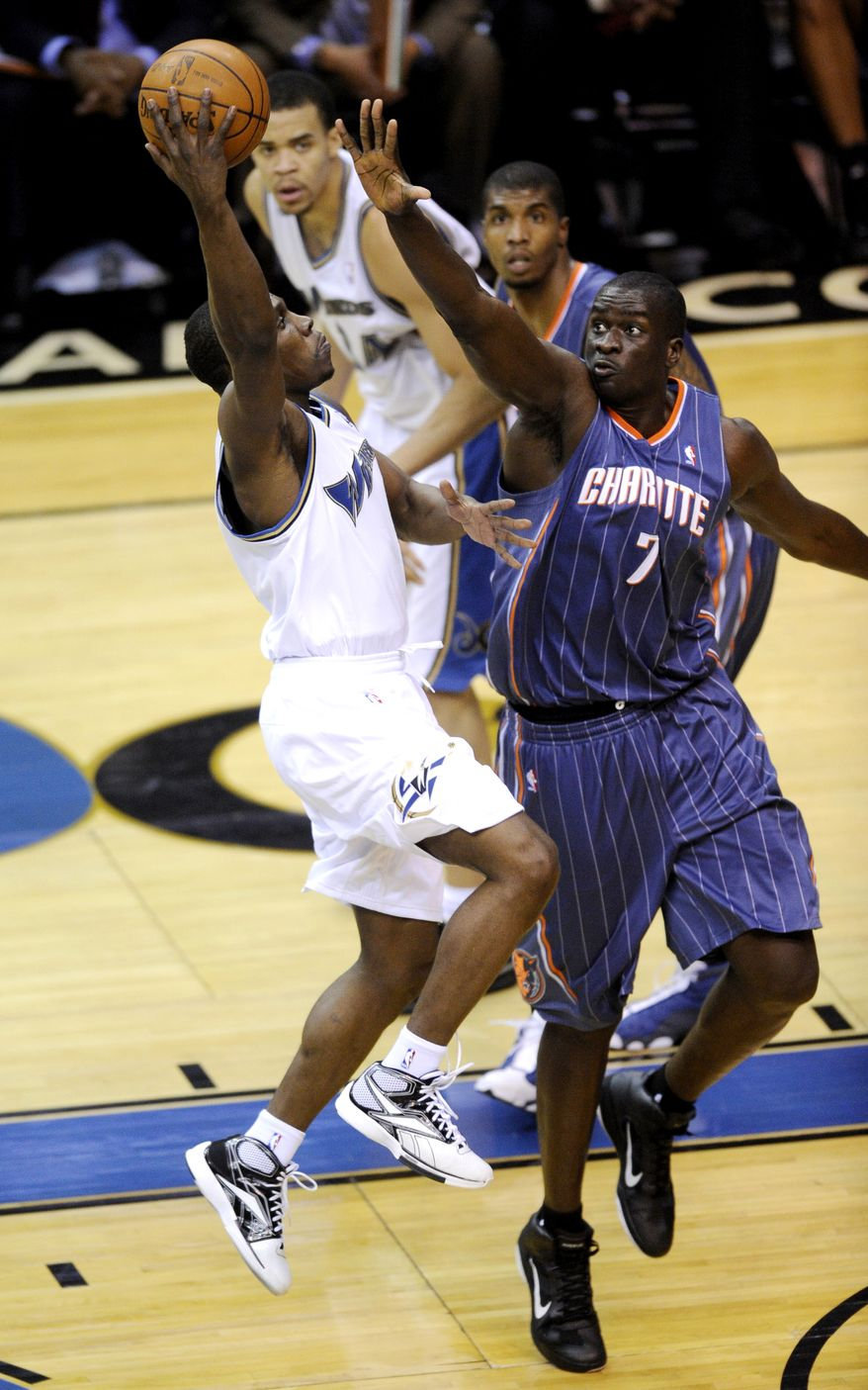 Washington Wizards Lester Hudson, left, goes to the basket against Charlotte Bobcats center DeSagana Diop (7) during the second half of an NBA basketball game, Monday, Dec. 20, 2010, in Washington. The Wizards won 108-75. (AP Photo/Nick Wass)