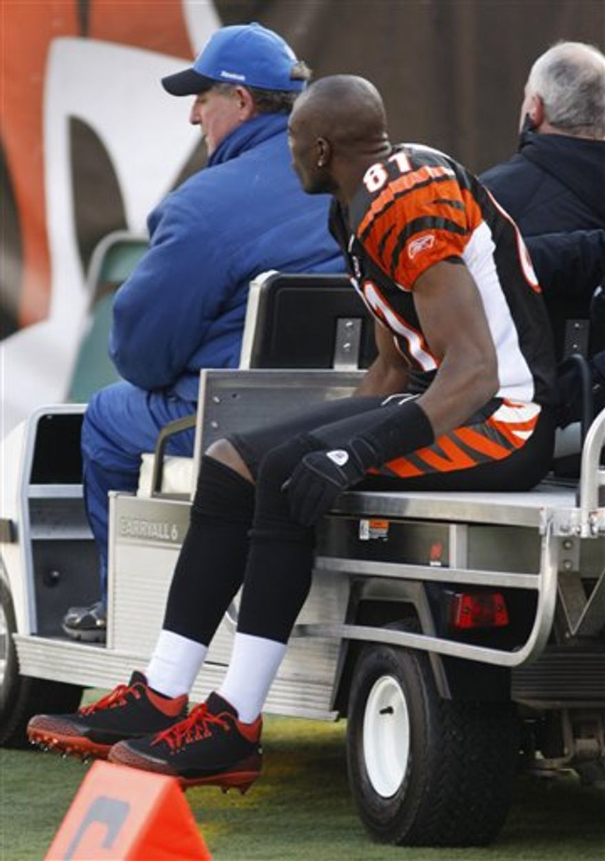 Cincinnati Bengals wide receiver Terrell Owens (81) rides off the field on a cart with a possible knee injury in the first half of an NFL football game against the Cleveland Browns, Sunday, Dec. 19, 2010, in Cincinnati. Owens return to the game is questionable. (AP Photo/David Kohl)