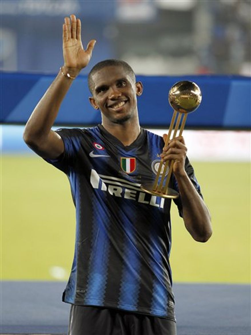 Inter Milan's Samuel Eto'o holds the trophy after winning the Club World Cup final soccer match against TP Mazembe at Zayed sport city in Abu Dhabi, United Arab Emirates, Saturday, Dec. 18, 2010. (AP Photo/Hassan Ammar)