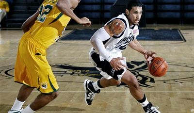 This Nov. 12, 2010 photo released by Long Island University shows Julian Boyd shooting a jumper against Norfolk State.It was Boyd's first game back since March 2009 when he was told he had  a heart condition known as noncompaction cardiomyopathy, part of his heart was enlarged. (AP Photo/Long Island University, Mike McLaughlin)