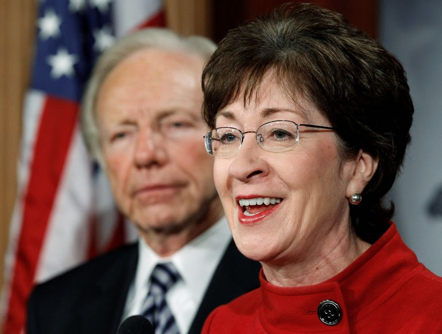 "Sen. Susan Collins speaks as Sen. Joseph I. Lieberman looks on during a news conference about the passage of the ""don't ask, don't tell"" bill on Capitol Hill on Saturday. (Associated Press)"