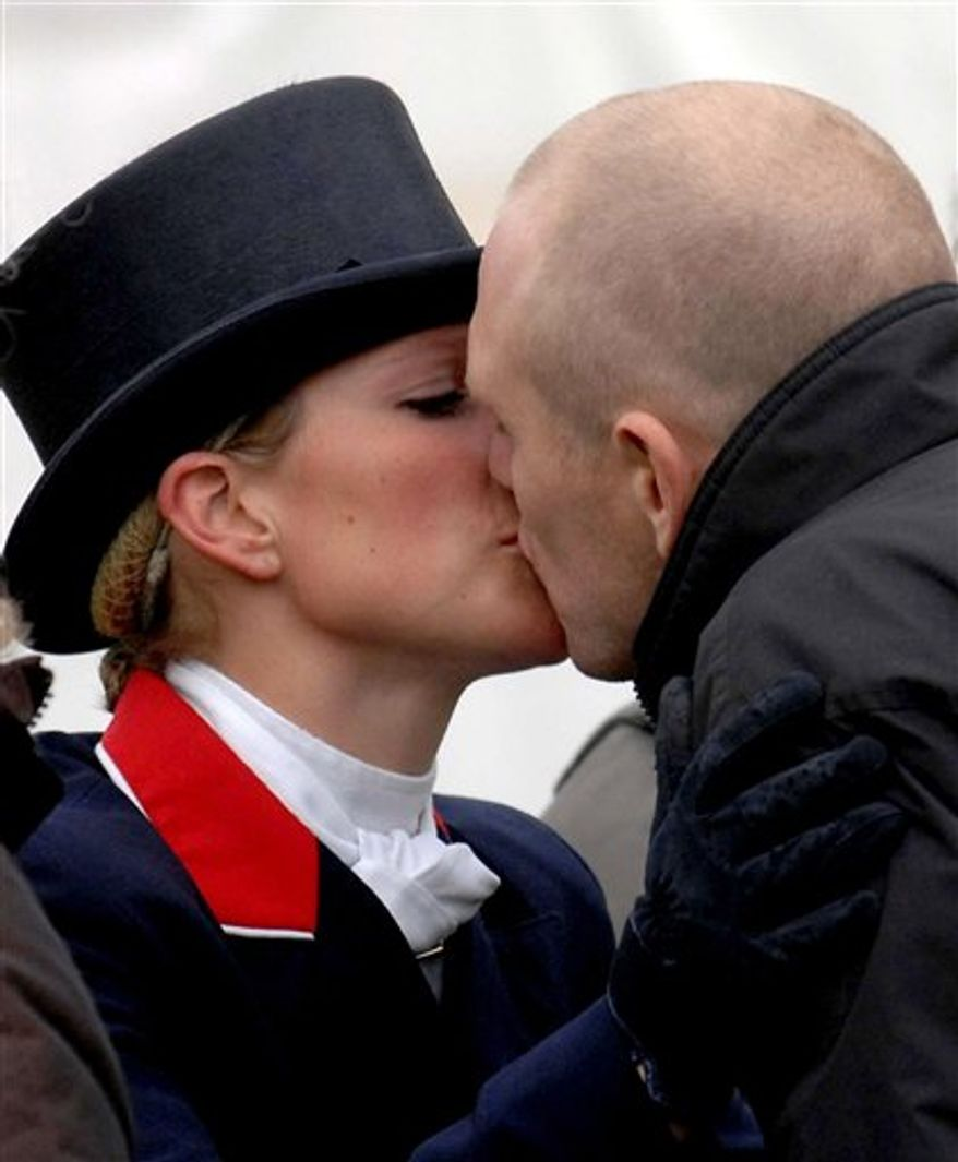 FILE -  In this file photo of May 4, 2007 Zara Phillips and boyfriend Mike Tindall kiss at the Badminton Horse Trials, Badminton, England. Buckingham Palace says Queen Elizabeth II's granddaughter Zara Phillips is engaged to her long-term boyfriend Mike Tindall. The palace said Tuesday Dec. 21, 2010 that 29-year-old Phillips, who is 12th in line to the throne, had accepted a proposal from rugby player Tindall. Phillips is the daughter of Princess Anne and her ex husband Capt. Mark Phillips, and the queen's eldest granddaughter. She has a successful career as an equestrian. (AP Photo/Barry Batchelor/PA Wire) UNITED KINGDOM OUT NO SALES NO ARCHIVE