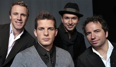 In this Oct. 8, 2010 photo, the Canadian Tenors, from left,  Fraser Walters, Clifton Murray, Victor Micallef and  Remigio Pereira pose for a photo in Los Angeles. (AP Photo/Damian Dovarganes)