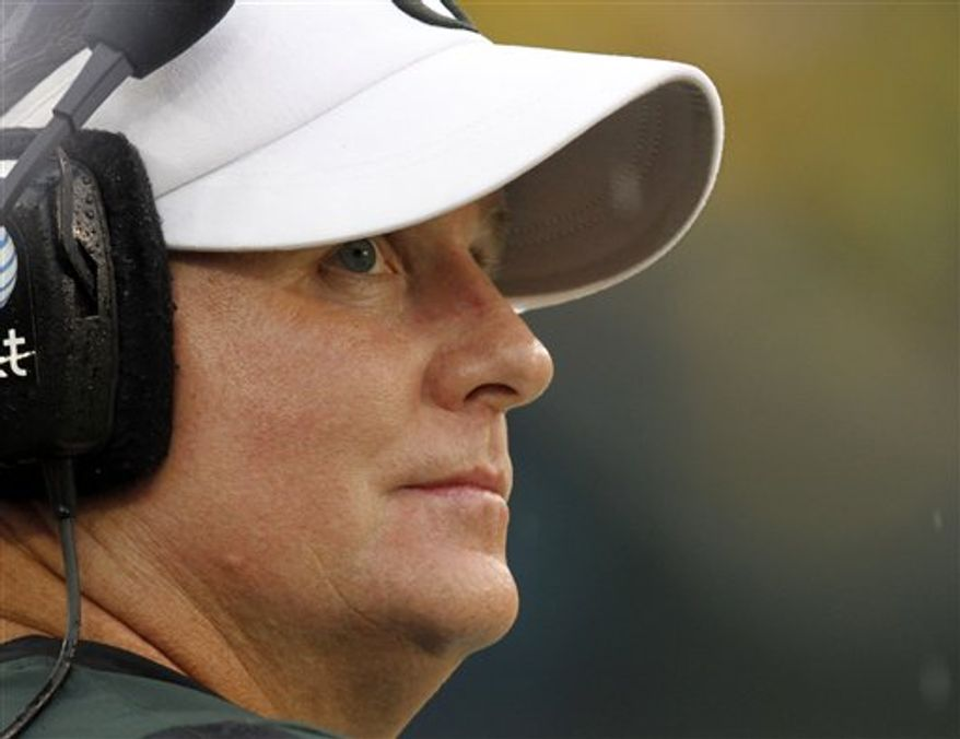 FILE - This Sept. 18, 2010, file photo shows Oregon head football coach Chip Kelly looking at the scoreboard late in the fourth quarter of their NCAA college football game against Portland State,  in Eugene, Ore. Kelly has been voted AP Coach of the Year, Tuesday, Dec. 21, 2010,  after leading the second-ranked Ducks to an undefeated record and a spot in the BCS national championship game in just his second season as the team's leader.  (AP Photo/Don Ryan, File)