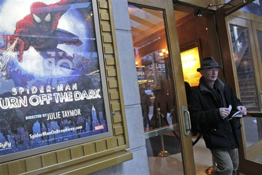 "People gather outside the Foxwoods Theatre in Times Square where the theatrical version  ""Spider-man Turn off  the Dark"" was canceled, Wednesday, Dec . 22, 2010, in New York. The curtain will go up again Thursday, Dec. 23, 2010 on ""Spider-Man: Turn Off the Dark"" after the producers of the accident-plagued Broadway musical agreed to new safety precautions to prevent another fall like the one that left a stuntman seriously injured.  (AP Photo/ Louis Lanzano)"