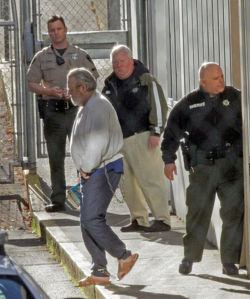 "ASSOCIATED PRESS PHOTOGRAPHS Bruce Turnidge is led away in chains after a jury decided the fate of the convicted bank bombers at the Marion County Circuit Court on Wednesday in Salem, Ore. He was called ""a murderer with no remorse."""