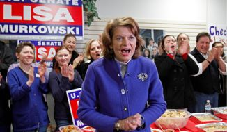 Associated Press photographs Sen. Lisa Murkowski, Alaska Republican, is seen here campaigning in Anchorage on Nov. 1, the day before the election in which she ran a write-in campaign. She won a state Supreme Court ruling on Wednesday.