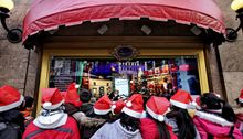 Students from Brooklyn's P.S. 105 wear Santa hats while on a field trip to view Christmas window displays at Macy's and other Manhattan department stores on Friday, Dec. 17, 2010, in New York. (AP Photo/Bebeto Matthews)