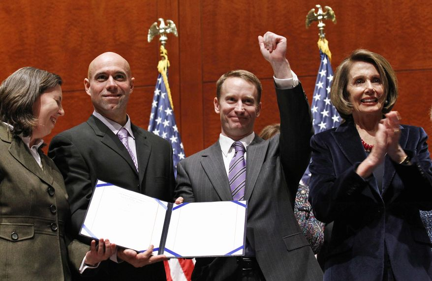 """House Speaker Nancy Pelosi (right), California Democrat, applauds as former service members Sgt. First Class Stacy Vasquez (left), current service member Lt. Col. Victor Fehrenbach and former service member Maj. Mike Almy hold the signed bill to repeal """"don't ask, don't tell"""" during an enrollment ceremony on Capitol Hill in Washington on Tuesday, Dec. 21, 2010. (AP Photo/Alex Brandon)"""