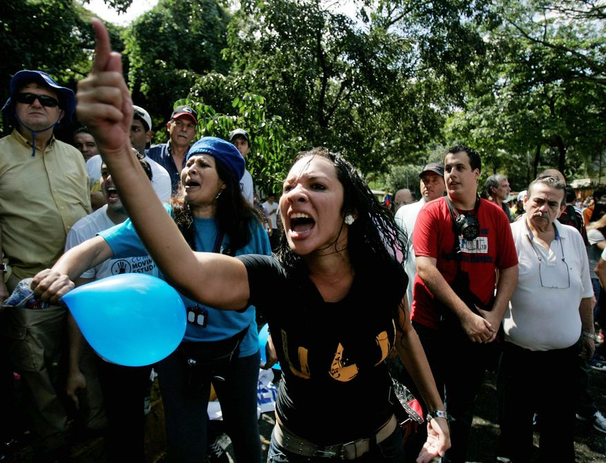 A university student shouts at national guard soldiers outside the Central University of Venezuela in Caracas. Police and soldiers fired water cannons and plastic bullets in a bid to quell the demonstrations.
