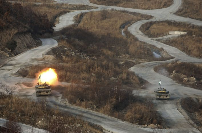 A South Korean K-1 tank fires live rounds on Thursday, Dec. 23, 2010, during the nation's largest joint air and ground military exercises at the Seungjin Fire Training Field in mountainous Pocheon, South Korea, 20 miles from the Koreas' heavily fortified border. (AP Photo/Wally Santana, Pool)