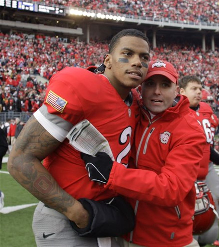 FILE - This nov. 27, 2010, file photo shows Ohio State's Terrelle Pryor, left, celebrating with quarterbacks coach Nick Siciliano after an NCAA college football game against Michigan, in Columbus, Ohio. Arkansas has faced more than its share of mobile quarterbacks this season _ with varying degrees of success. Ohio State's Pryor is next on that list for the eighth-ranked Razorbacks (10-2), who conclude their on-campus preparations Thursday, Dec. 23, 2010, for the Jan. 4 Sugar Bowl. (AP Photo/Jay LaPrete, File)