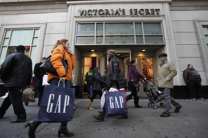 "In this Dec. 18, 2010 photo, shoppers are photographed on 34th Street, in New York. Call it Black Friday, Part II. Stores are rolling out the deals and expect to be swimming in shoppers on Christmas Eve as shopping stragglers take advantage of a day off work. For retailers, the last-minute rush caps a ""back-to-normal"" holiday season. (AP Photo/Mary Altaffer)"