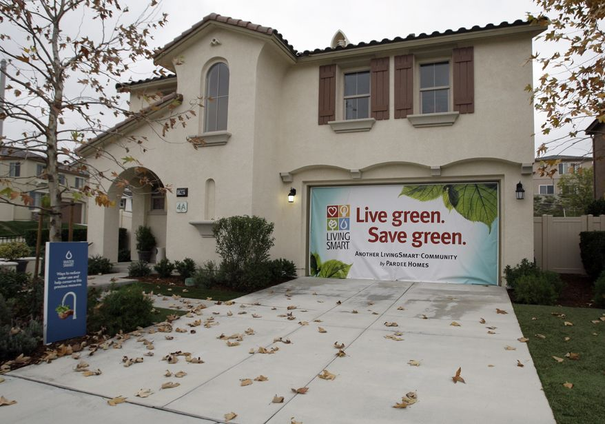 Pardee Homes touts the 'green' aspect of its new Fair Oaks Ranch homes in Santa Clarita, Calif., on Wednesday, Dec. 15, 2010. More people purchased new homes in November, but not enough to signal that better times are ahead for the battered housing industry. (AP Photo/Reed Saxon)