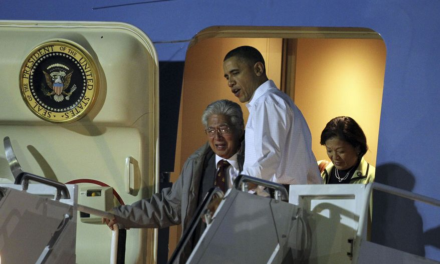President Obama arrives at Hickam Air Force Base in Honolulu with Sen. Daniel K. Akaka (left) and Rep. Mazie K. Hirono, both Hawaii Democrats, on Wednesday, Dec. 22, 2010. (AP Photo/Chris Carlson)