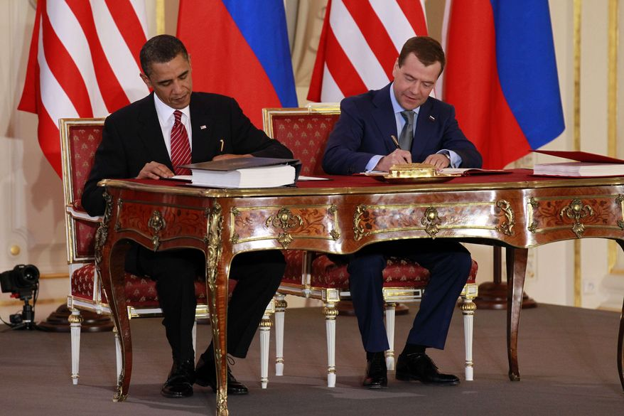 ** FILE ** President Barack Obama, left, and Russian president Dmitry Medvedev sign the New START treaty at the Prague Castle in Prague in this April 8, 2010, file photo. (AP Photo/Alex Brandon, File)