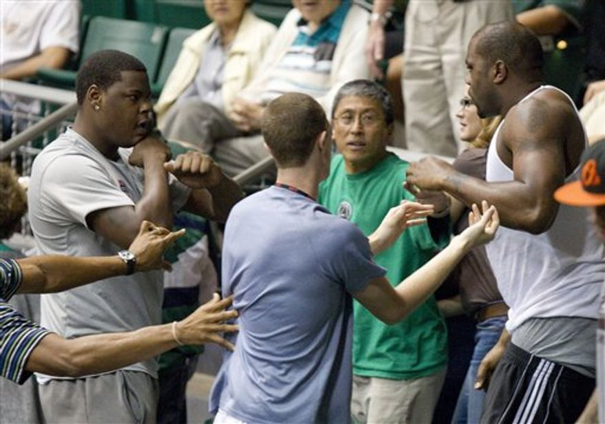 Renardo Sidney, far left, and Elgin Bailey, far right, both teammates with the Mississippi State basketball team fight in the stands before the start of the Utah/Hawaii basketball game at the Diamond Head Classic, Thursday, Dec. 23, 2010, in Honolulu. (AP Photo/Eugene Tanner)