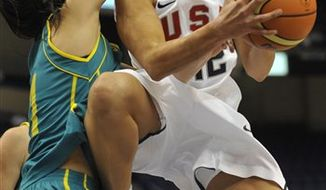 FILE - This Sept. 10, 2010, filoe photo shows USA's Diana Taurasi driving to the basket while guarded by Australia's Laura Summerton, left,  during the second half of an exhibition basketball game,  in Hartford, Conn. The Turkish basketball federation says a stimulant used to counter excessive sleepiness was the banned substance Diana Taurasi tested positive for, leading to the WNBA standout's suspension from the pro team she's playing for in Turkey. (AP Photo/Jessica Hill, File)