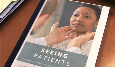 "In this Dec. 21, 2010 photo, a proof copy of the book, ""Seeing Patients,"" rests on Harvard Medical School professor Augustus White's desk in Boston. White's memoir calls for more diversity in the medical field and an end to health care disparities. (AP Photo/Chitose Suzuki)"